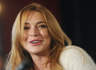 Lohan says on reality show she had miscarriage