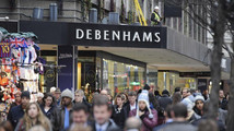 Debenhams to cut back promotions after profit drop