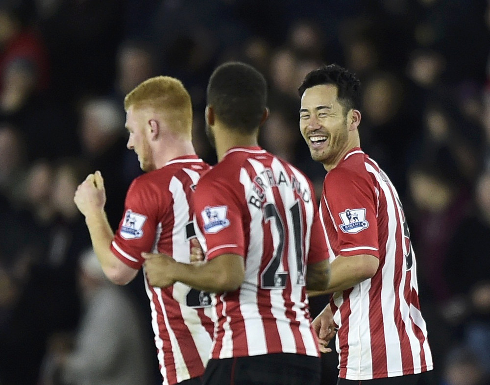 Southampton's Maya Yoshida celebrates with team-mates after scoring a goal against Everton during their English Premier League soccer match at St Mary's Stadium in Southampton