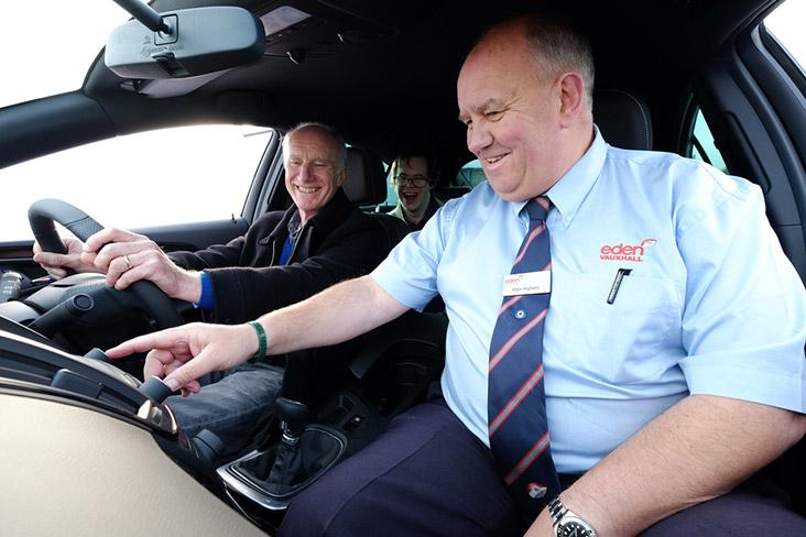 Motability Scheme customer getting a car demonstration from Motability Scheme Specialist