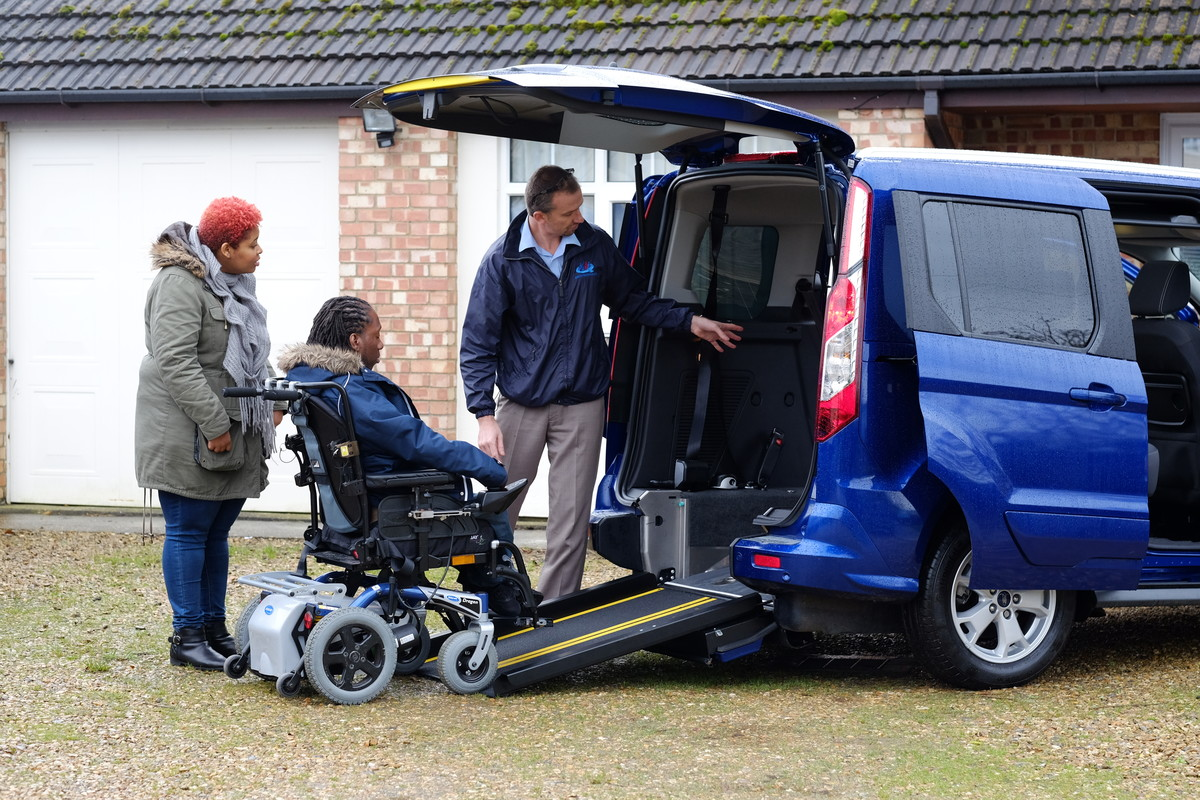 Powered wheelchair user driving into WAV