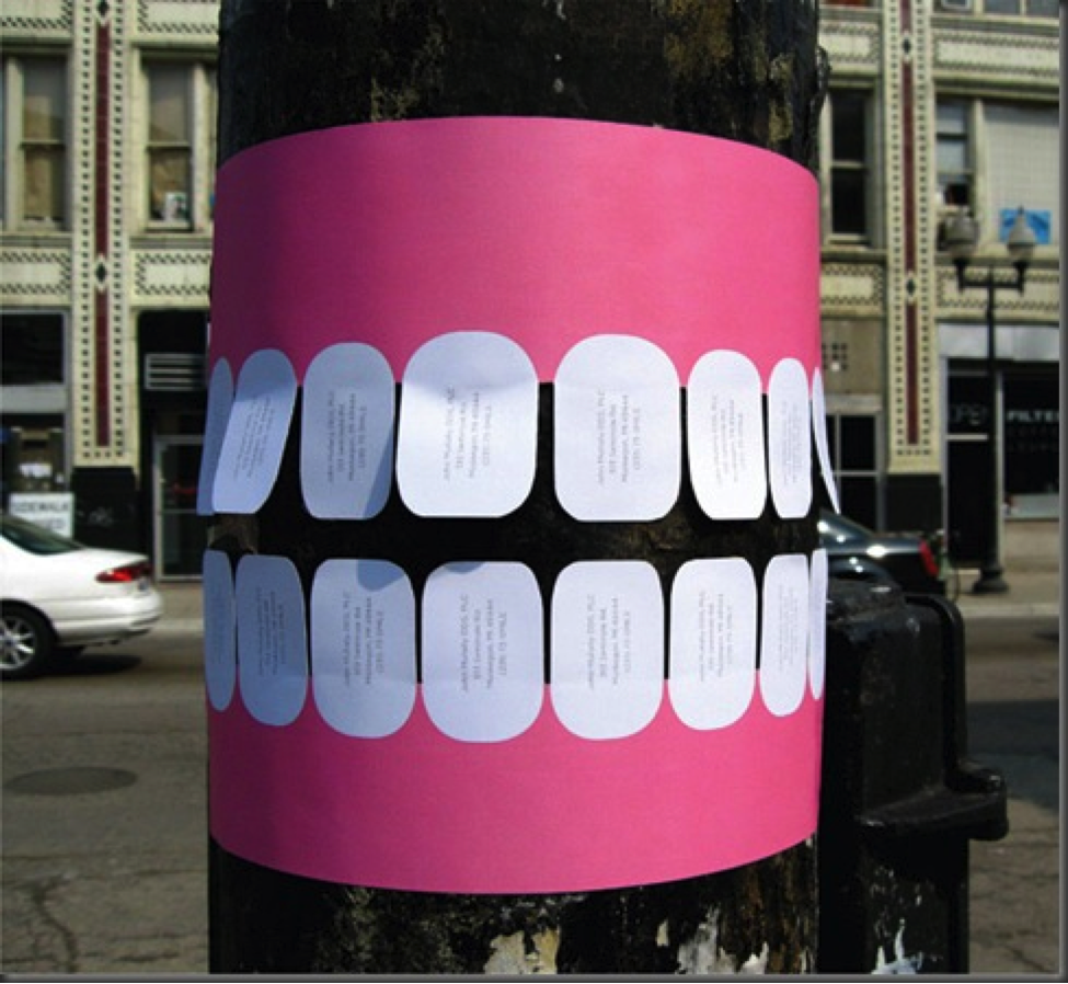 poster on telephone pole.png