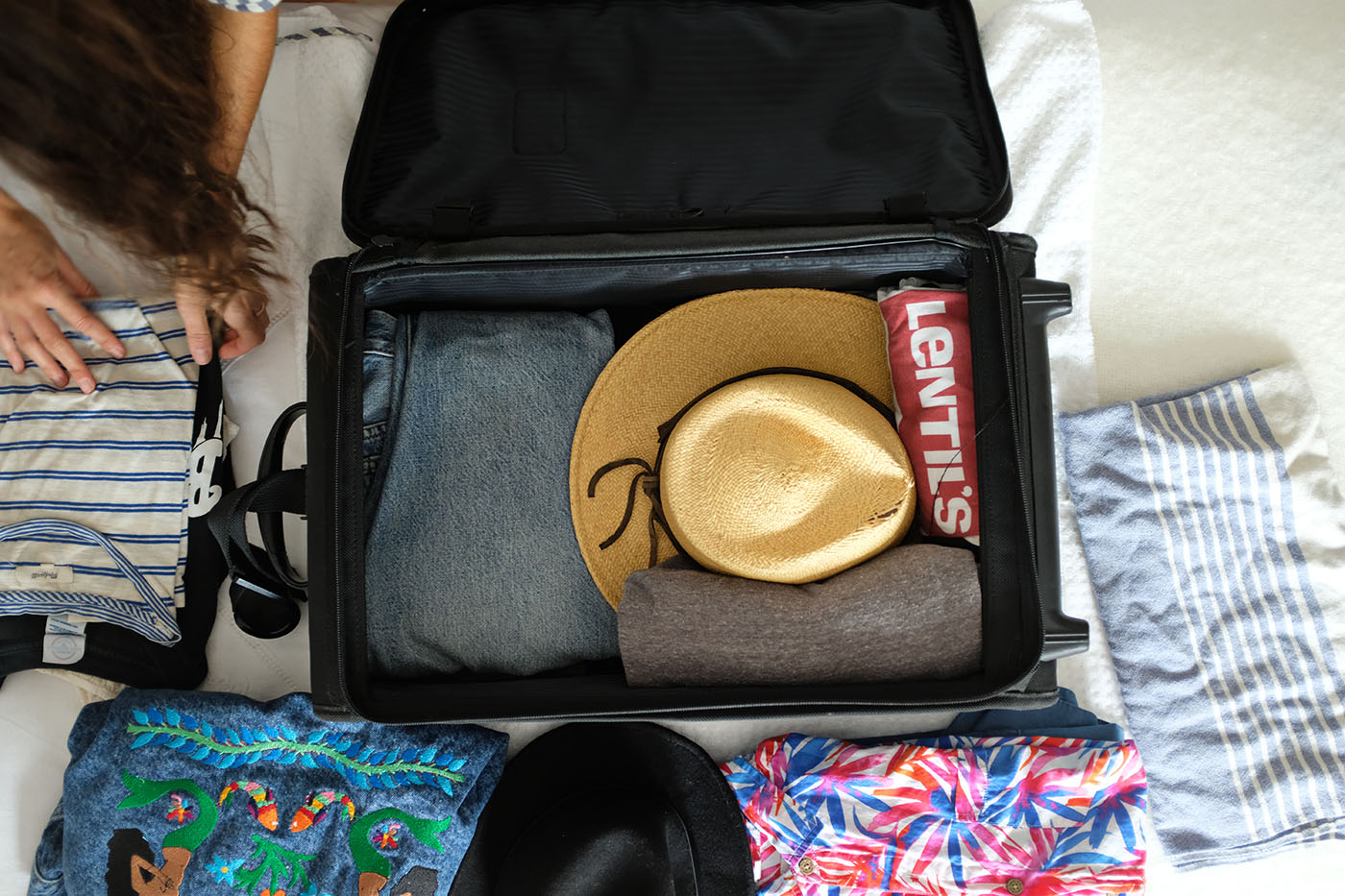 ohdeardrea-travel-blog-how-to-pack-a-hat-rolls-1.jpg
