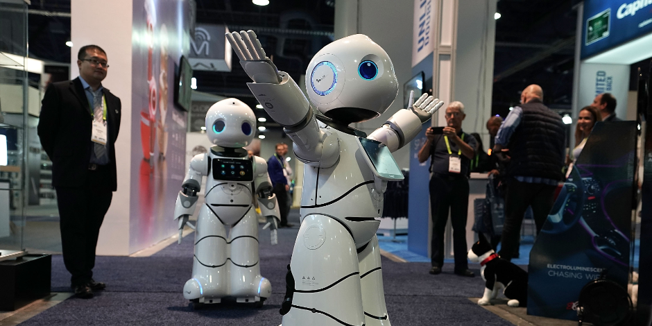 The U-Partner U05 humanoid service robots by Canbot, featured with free speech interaction, microsecond-level face recognition, autonomous obstacle avoidance walking, bionic action control and smart home hub, greet attendees during CES 2018 at the Las Veg