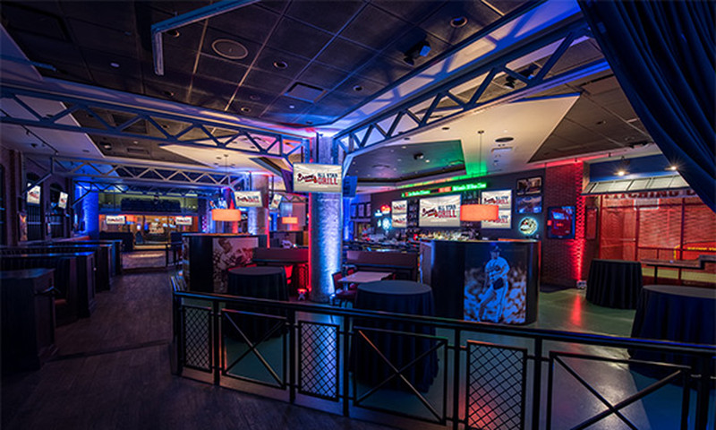 The Braves All Star Grill features a sports shop, a pitcher's cage, 30 TVs and a long bar.