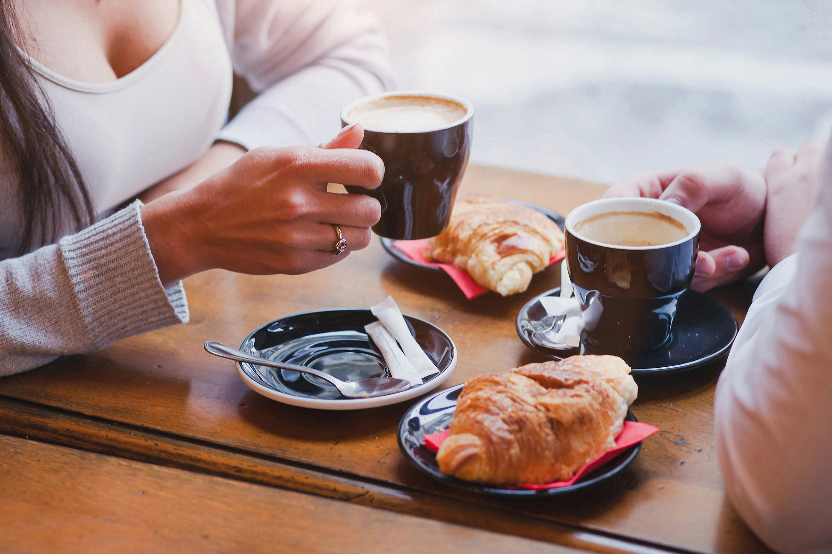 coffee and croissants in cafe, couple having breakfast
