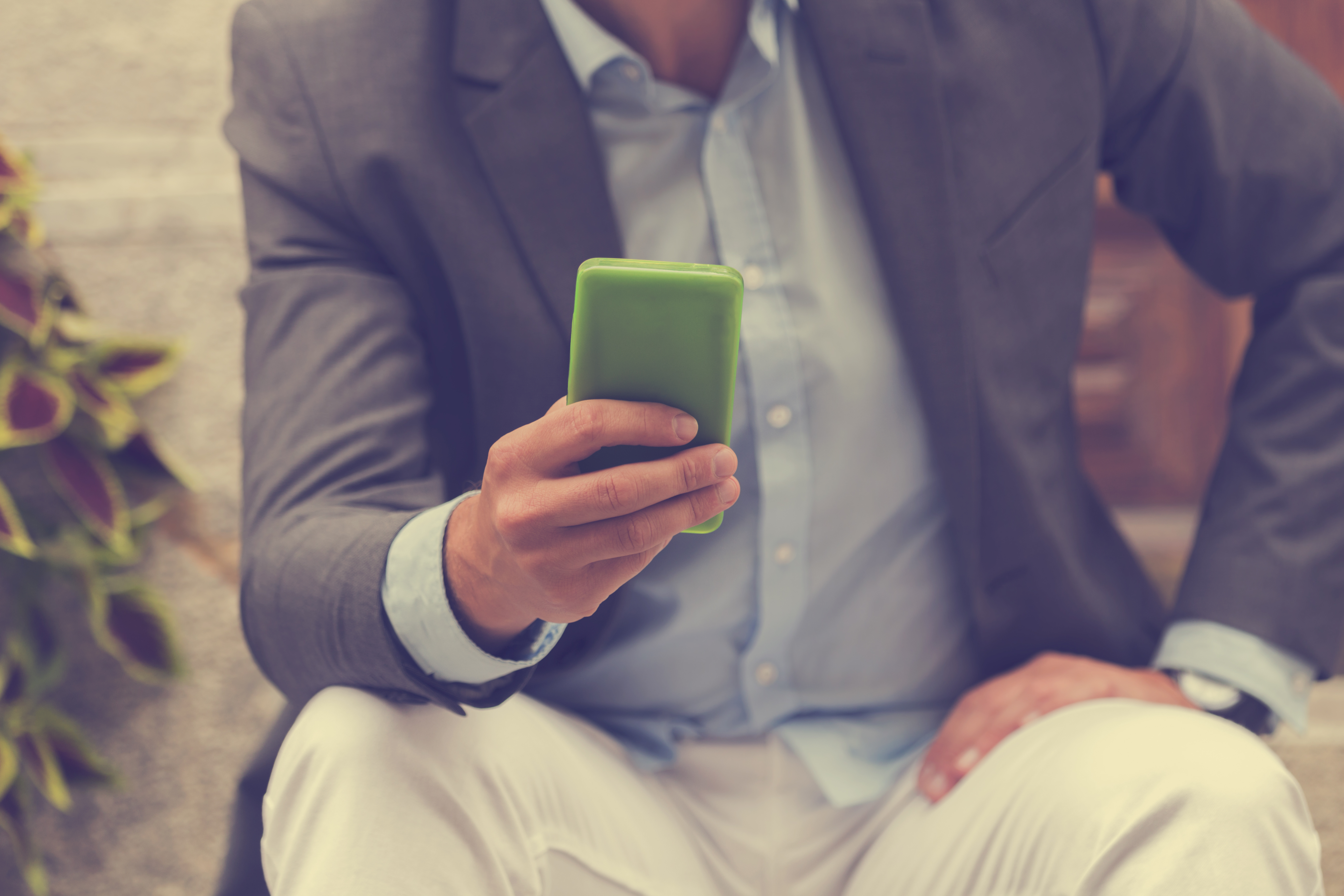 Handsome man using smartphone.