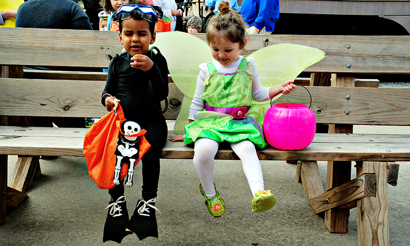 Costumed cuties waiting for a ride at Train or Treat.