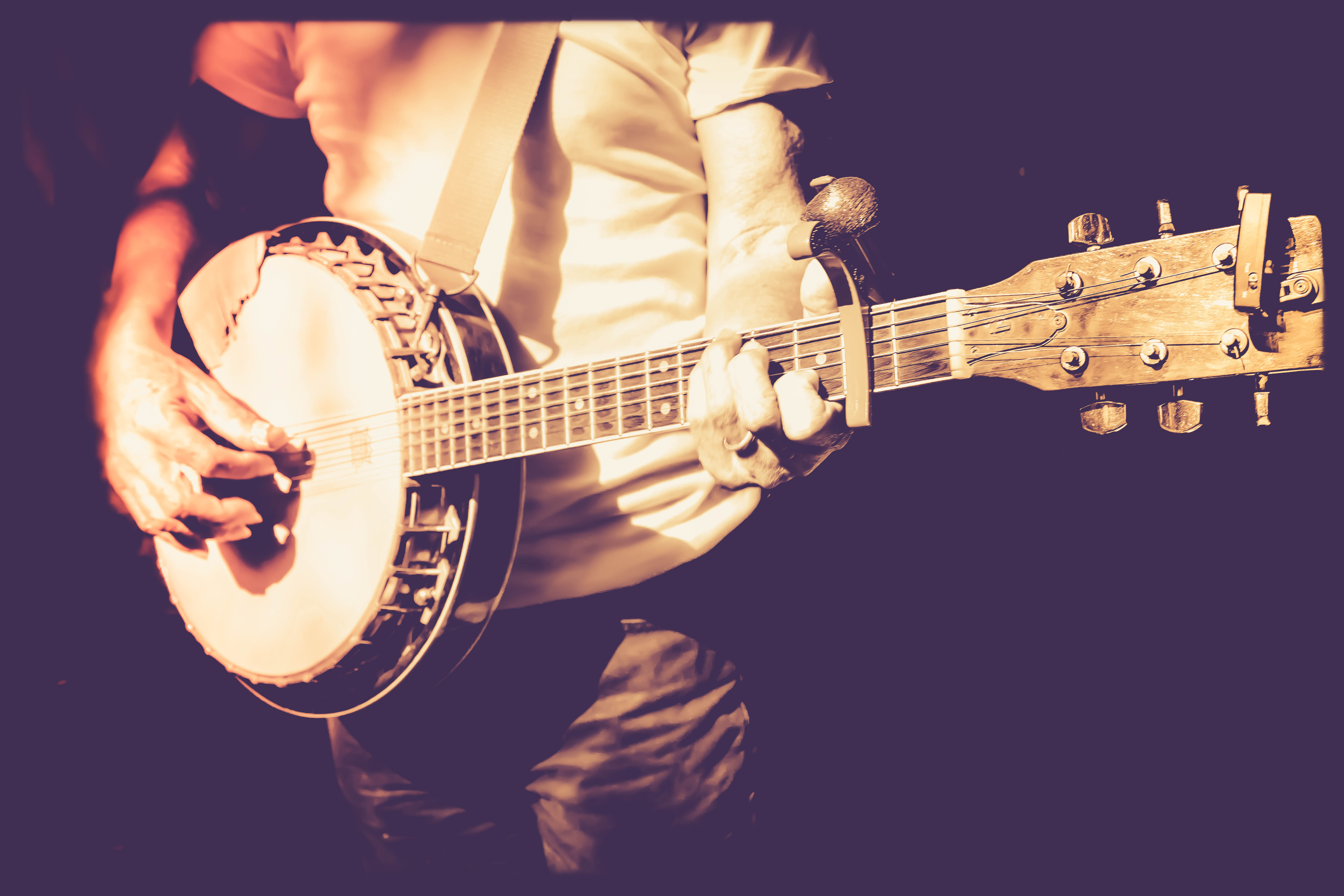 musician playing banjo in retro filter photo