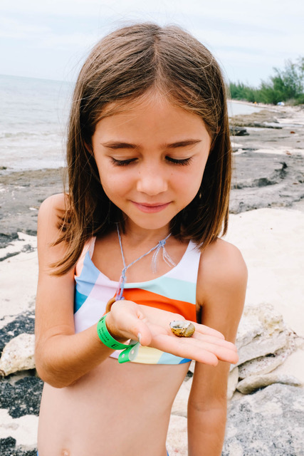 daughter holding small shell