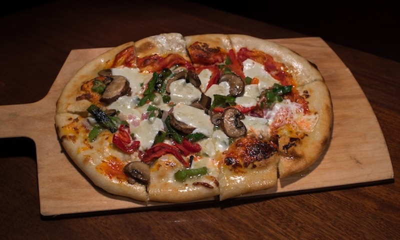 There are so many tempting menu options, like this veggie flatbread, at Village Tavern in Alpharetta.