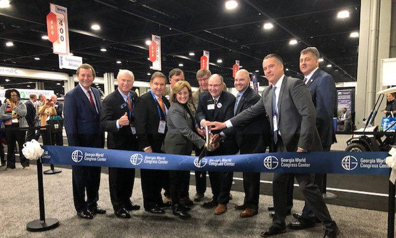 William Pate, president and CEO of Atlanta Convention & Visitors Bureau; State Senator Butch Miller, chairman of GWCCA's Legislative Overview Committee; Bill Russell, GWCCA chair; IPPE leadership and stakeholders celebrate the opening of Exhibit Hall BC.