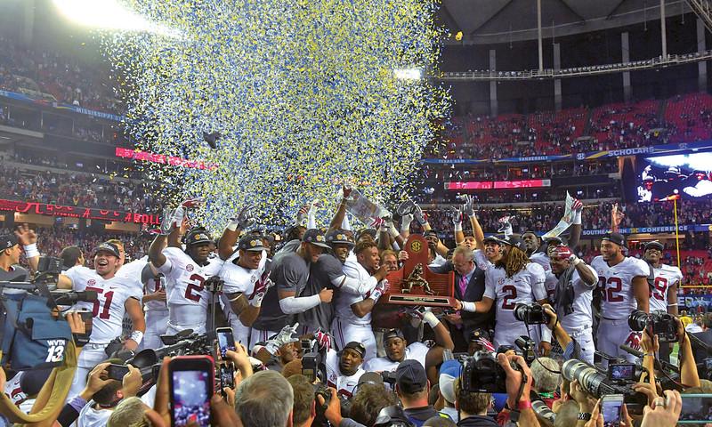 Atlanta Falcons celebrating in Mercedes-Benz Stadium.