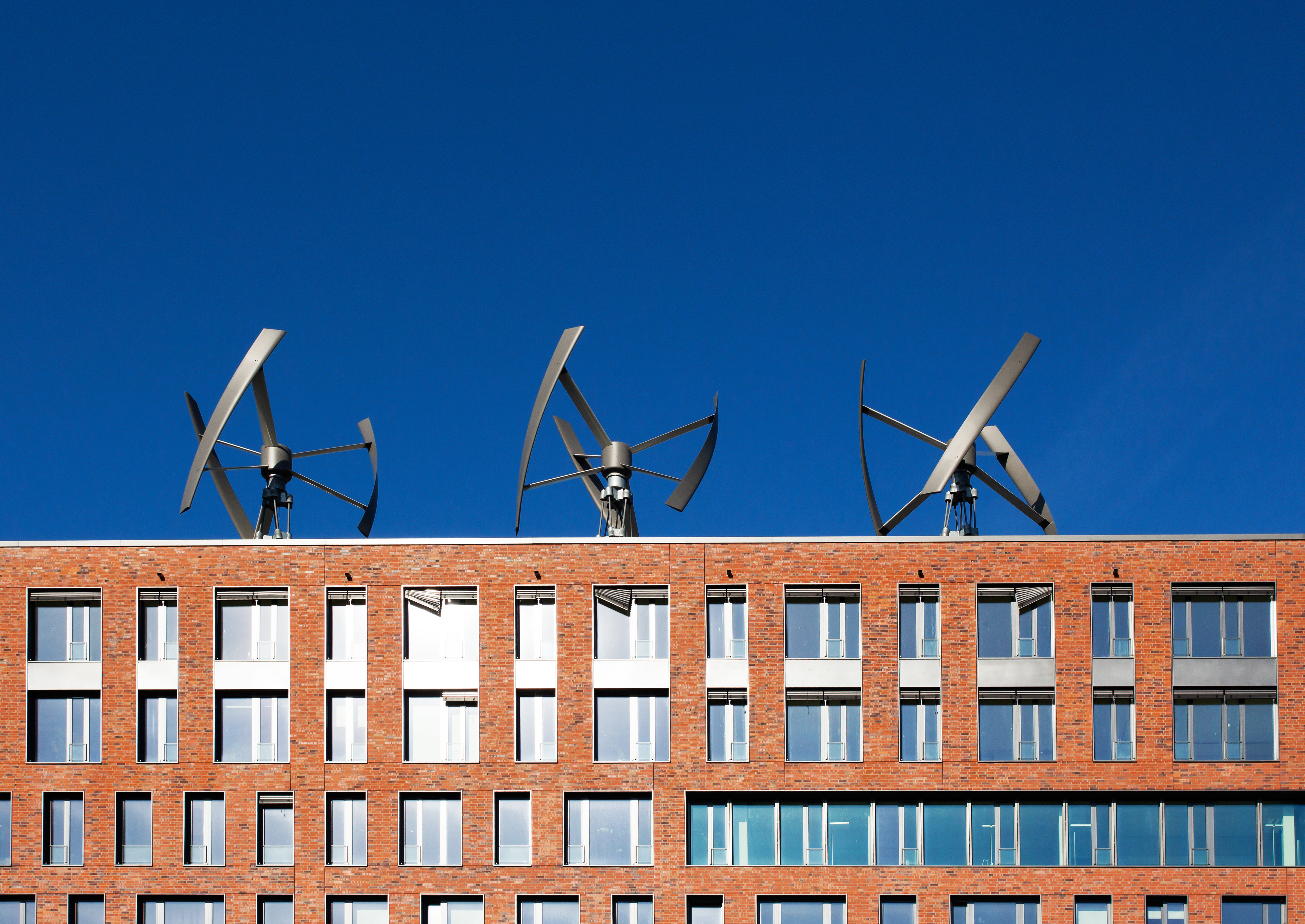 Wind turbines on the roof of a building