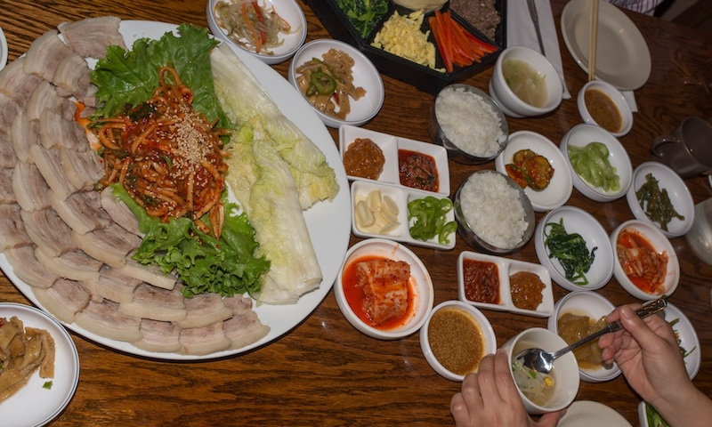 Bring friends to help you eat the many dishes at Woo Nam Jeong Stone Bowl House.