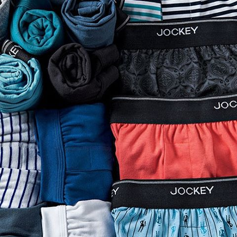 Jockey boxer briefs and boxers folded in a drawer.